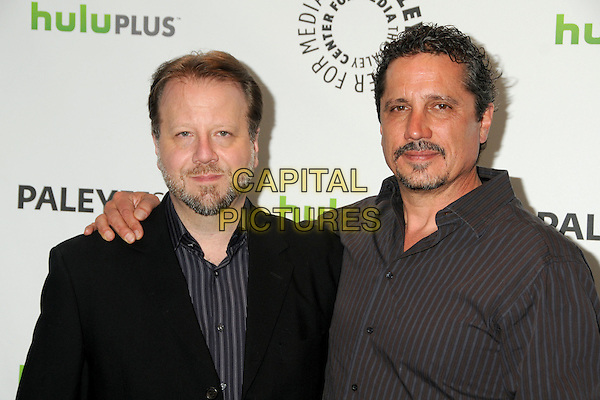 """Andrew Marlowe, Rob Bowman.PaleyFest 2012 Presents """"Castle"""" held at The Saban Theatre, Beverly Hills, California, USA, 9th March 2012..half length arm around black jacket grey gray shirt striped  .CAP/ADM/BP.©Byron Purvis/AdMedia/Capital Pictures."""