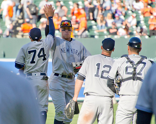 From left to right: New York Yankees third baseman Ronald Torreyes (74), right fielder Aaron Judge (99), third baseman Chase Headley (12), and catcher Austin Romine (27) celebrate their team's 7 - 3 victory over the Baltimore Orioles at Oriole Park at Camden Yards in Baltimore, MD on Sunday, April 9, 2017.<br /> Credit: Ron Sachs / CNP<br /> (RESTRICTION: NO New York or New Jersey Newspapers or newspapers within a 75 mile radius of New York City)