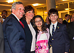 Nassau County Executive Edward Mangano gives State of the County Address, on Wednesday night, March 14, 2012, at Cradle of Aviation museum, Garden City, New York, USA. Mangano at left shown with family of John Capano, the ATF agent Alcohol Tobacco & Firearms) fatally shot months earlier while trying to stop a pharmacy robbery.