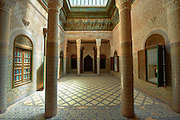 Berber Muqarnas Arabesque stalactite plaster work ceiling and Mocarabe Honeycomb work plaster columns and capitals of the inner courtyard of  the Kashah of Telouet, Morocco