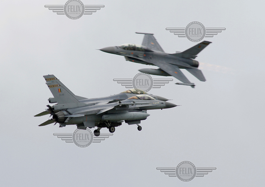 Belgian F-16 perform an air display during Tiger Air show.  Nato Tiger Meet is an annual gathering of squadrons using the tiger as their mascot. While originally mostly a social event it is now a full military exercise. Tiger Meet 2012 was held at the Norwegian air base Ørlandet.