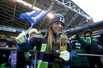 Seattle Seahawks fan Casey Crust  waves a 12th Man flag and holds a ticket to the Super Bowl during a championship celebration at  CenturyLink Field with Seahawks players, coaches, and staff on February 5, 2014 in Seattle. Crust was one of thousands of fans who braved temperatures in the mid-20's to greet the team after the club's 43-8 victory over the Denver Broncos in Super Bowl XLVIII.