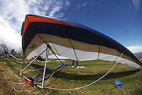 AIR SPORTS<br /> Assembled Hang Glide<br /> .Stiff aluminum struts inside the fabric give the wing its shape. The pilot, suspended from the glider's center of mass from a harness, maneuvers by shifting his or her weight.