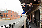 December 22, 2014. Lexington, North Carolina.<br />  Mayor Newell Clark, right, and his cousin Stan Lanier do pull-ups at an old railroad depot as part of their exercise routine.<br />  Newell Clark, the 43 year old mayor of Lexington, NC, leads a group of friends and colleagues on a 4 times a week exercise routine around downtown. The group uses existing infrastructure, such as an abandoned furniture factory, loading docks, stairs, and handrails to get fit and increase awareness of healthy lifestyles in a town more known for BBQ.<br /> Jeremy M. Lange for the Wall Street Journal<br /> Workout_Clark