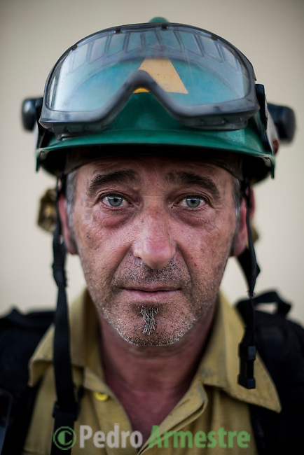 Francisco Illescas. The firefighter from the BRICA Málaga 703, the Andalusian Service firefighting (INFOCA),  posses after a wildfire in Los Barrios near Cadiz on July 25, 2015. © Pedro ARMESTRE