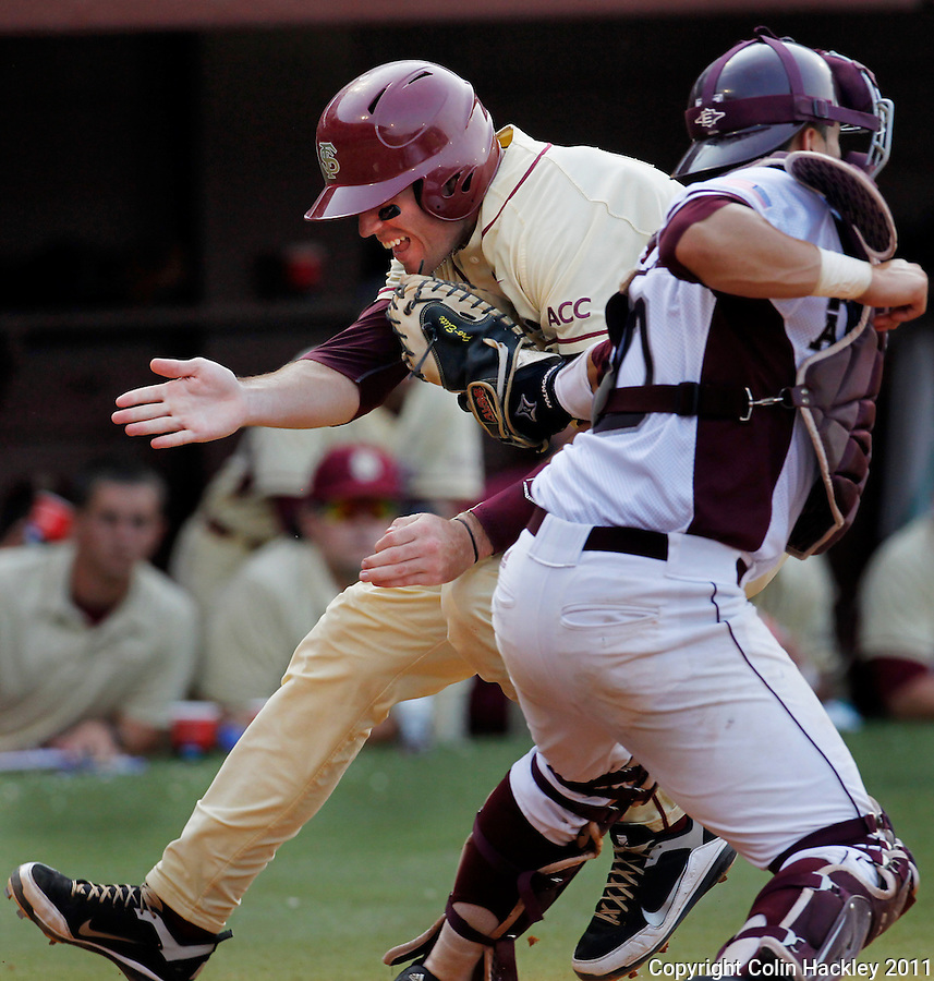 TALLAHASSEE, FL 10-FSU-TAMUBASE11 CH-Florida State's Jayce Boyd collides with Texas A&M catcher Kevin Gonzalez to score in the fourth inning Sunday at Dick Howser Stadium during NCAA Super Regional action in Tallahassee. The Seminoles beat the Aggies 23-9 to stay alive in the best of three series...COLIN HACKLEY PHOTO