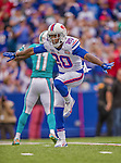 14 September 2014: Buffalo Bills cornerback Corey Graham (20) indicates no catch after he breaks up a pass intended for Miami Dolphins wide receiver Mike Wallace (11) in the first quarter at Ralph Wilson Stadium in Orchard Park, NY. The Bills defeated the Dolphins 29-10 to win their home opener and start the season with a 2-0 record. Mandatory Credit: Ed Wolfstein Photo *** RAW (NEF) Image File Available ***