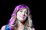 "Colbie Caillat looks out over the audience as she performs her hit song ""Bubbly"" during the 10th Annual Jingle Bell Bash at the Tacoma Dome in Tacoma, WA., on December 4, 2007.  Jim Bryant Photo. ©2007. All Rights Reserved."