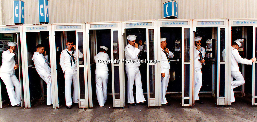 Sailors hit the phone banks after getting off the USS Carl Vinson when the carrier docked at Alameda Naval Air Station in Alameda, Ca (copyright 1993 Ron Riesterer)