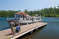 The National Park Service shuttle Voyageur II visits a dock at McCargo Cove at Isle Royale National Park.