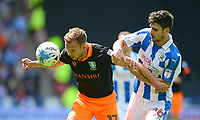 Sheffield Wednesday's Jordan Rhodes shields the ball from Huddersfield Town's Christopher Schindler<br /> <br /> Photographer Chris Vaughan/CameraSport<br /> <br /> The EFL Sky Bet Championship Play-Off Semi Final First Leg - Huddersfield Town v Sheffield Wednesday - Saturday 13th May 2017 - The John Smith's Stadium - Huddersfield<br /> <br /> World Copyright &copy; 2017 CameraSport. All rights reserved. 43 Linden Ave. Countesthorpe. Leicester. England. LE8 5PG - Tel: +44 (0) 116 277 4147 - admin@camerasport.com - www.camerasport.com