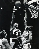 Golden state Warrior Nate Thurmond tries to block the shot of Los Angeles Lakers Wilt Chamberlain. (copyright 1967 Ron Riesterer)