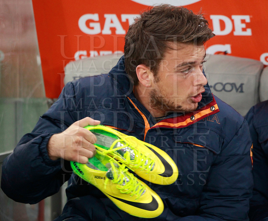 Calcio, Serie A: Roma vs Udinese. Roma, stadio Olimpico, 17 marzo 2014.<br /> AS Roma forward Adem Ljajic, of Serbia, holds his football boots as he sits on the bench during the Italian Serie A football match between AS Roma and Udinese at Rome's Olympic stadium, 17 March 2014.<br /> UPDATE IMAGES PRESS/Isabella Bonotto