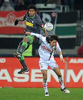 FUSSBALL   1. BUNDESLIGA  SAISON 2011/2012   16. Spieltag FC Augsburg - Borussia Moenchengladbach            10.12.2011 Dante Bonfim (li, Borussia Moenchengladbach) gegen Hajime Hosogai (FC Augsburg)