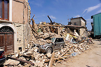 Onna  10 Aprile 2009.Terremoto Abruzzo.Macerie nelle vie del paese devastato dal terremoto.A pile of rubble  in the main street of the devastated small village ..