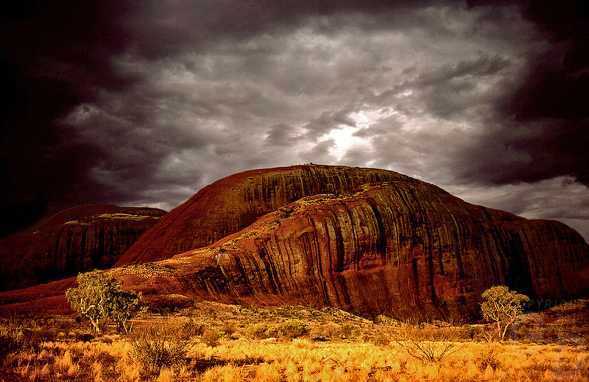 THE OLGAS DURING A STORM AT SUNSET