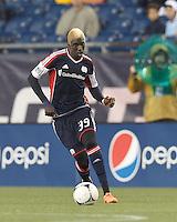 New England Revolution forward Saer Sene (39) brings the ball forward. In a Major League Soccer (MLS) match, the New England Revolution defeated Chicago Fire, 2-0, at Gillette Stadium on June 2, 2012.