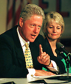 "United States President Bill Clinton makes a point during a presentation at an ""Education Roundtable"" at Herndon Elementary School in Herndon, Virginia on August 31, 1998.  Martha Bell, a teacher at the school looks on from right..Credit: Ron Sachs / CNP"