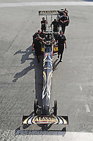 Jan. 17, 2012; Jupiter, FL, USA: Crew members push the car of NHRA top fuel dragster driver Khalid Albalooshi during testing at the PRO Winter Warmup at Palm Beach International Raceway. Mandatory Credit: Mark J. Rebilas-