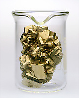 CRYSTAL DOES NOT TAKE CONTAINER SHAPE<br /> A solid (pyrite crystals) has its own shape. It will not fill a container conforming to the shape of the container unless it is finely divided.
