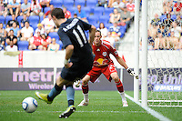 New York Red Bulls goalkeeper Greg Sutton (24) watches as Adam Johnson (11) of Manchester City F. C. crosses the ball. The New York Red Bulls defeated Manchester City F. C.2-1 during a Barclays New York Challenge match at Red Bull Arena in Harrison, NJ, on July 25, 2010.