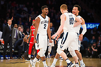 NEW YORK, NY - Thursday March 9, 2017: Kris Jenkins (#2) of Villanova and teammates celebrate their big lead over St. John's as the two schools square off in the Quarterfinals of the Big East Tournament at Madison Square Garden.