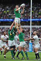 Peter O'Mahony of Ireland rises high to win lineout ball. QBE International match between England and Ireland on September 5, 2015 at Twickenham Stadium in London, England. Photo by: Patrick Khachfe / Onside Images