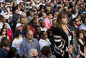 Spectators at the National September 11 Memorial at the World Trade Center Site in New York, New York on September 11, 2011. .Credit: Kristoffer Tripplaar / Pool via CNP