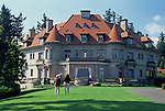Pittock Mansion with tourists looking at the historic home of Henry and Georgiana Pittock Portland Oregon State USA