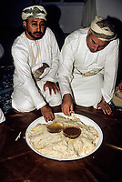 Mudhaireb (Mudayrib), Oman.  Eating Arsiya, the first food eaten on the Eid al-Adha, before prayers.  Made of rice, meat, grapes, lemon, spices, water, ghee.