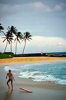 boy with boogie board at Poipu beach, Kauai