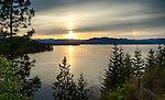 Idaho, North, Coolin. A hazy sunset and sundog over Priest Lake on the first day of summer, 2014.