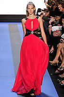 Anya walks runway in a magenta chiffon gown with crackle leather banded bodice and side lace insert, by Monique Lhuillier, from the Monique Lhuillier Spring 2012 collection fashion show, during Mercedes-Benz Fashion Week Spring 2012.