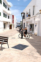 MR Young woman on her bike, in Sant Francesc de Formentera, Spain