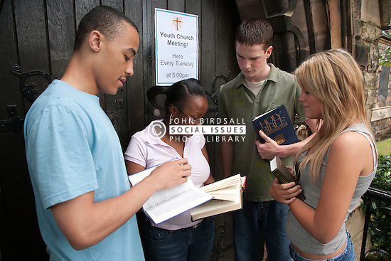 Group of teenagers outside church.
