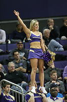 December 22, 2013:  Washington cheerleader Sarah Madsen entertained fans during a timeout against Connecticut.  Connecticut defeated Washington 82-70 at Alaska Airlines Arena Seattle, Washington.