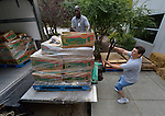 Jerrod Perrin (left) of Interfaith Food Shuttle and Bill Rickrode, a volunteer for Urban Ministries of Wake County, unload donated food at Urban Ministries' Food Pantry in Raleigh, North Carolina.