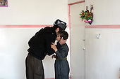 BIARA, IRAQ: Abit al-Jabar (20) kisses his nephew on a rare trip back to his parents' house...The Biara Madrassa--a religious school--is located high up in the mountainous Kurdish Hawraman region that makes up the Iran/Iraq border. Before 2003 the region was home to a fundamentalist Islamic group called Ansar al-Islam who used the school as a base. The Unites States military attacked the area and the madrassa numerous times during the 2003 invasion, finally pushing Ansar al-Islam out...Today the madrassa is home to 48 male students from all across Kurdish Iraq. The students leave their families and immerse themselves in their studies and the daily life of Koranic students...Photo by Besaran Tofiq