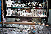 A shop keeper looks out through a maze of jewels in his jewellery store in Dariba Kalan, Old Delhi, India. Photo: Sanjit Das/Panos Pictures