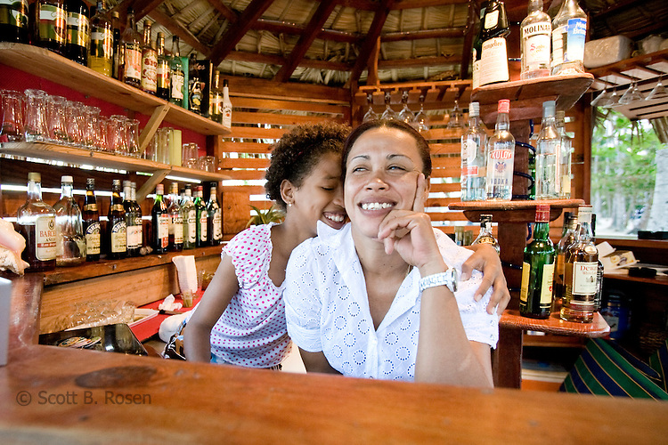 Dominican woman and girl at a beachside bar in Las Terranas, Samana, Dominican Republic