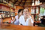 Dominican woman and girl at a beachside bar in Las Terranas, Samana, Dominican Republic