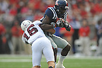Ole Miss' Derrick Herman (26) is tackled by Southern Illinois' Luke Thuston (16) at Vaught-Hemingway Stadium in Oxford, Miss. on Saturday, September 10, 2011. The play was called back due to penalty.