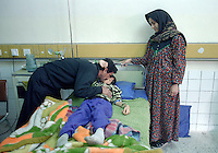 (February 1998) Nine year old Haiman Sabri with his parents at the Saddam hospital in Baghdad. <br /> According to his doctor Haiman had a curable infection, but due to lack of anti biotics suffered life threatening complications.  <br /> Due to UN sanctions the hospital was lacking many medicines, and the civilians suffered due to lack of food as well. <br />  Former U.N. Humanitarian Coordinator in Iraq Denis Halliday estimated the resulting deaths : &quot;Two hundred thirty-nine thousand children 5 years old and under&quot; as of 1998.<br /> <br /> The sanctions against Iraq were a near-total financial and trade embargo imposed by the United Nations Security Council on the Iraqi Republic.<br /> <br /> <br /> &copy;Fredrik Naumann/Felix Features