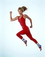 Christie Brinkley exercises in red leotard and striped leg warmers. Studio shoot, Los Angeles, 1982. Photo by John G. Zimmerman.