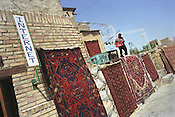 A carpet trader shop, with internet access, in the Old Silk Road trading route city of Bukhara, Uzbekistan