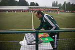 Fourth official Ferenc Bede of Hungary preparing the substitutes board during the The New Saints versus Bohemians game at Park Hall Stadium, Oswestry in the Champions League 2nd qualifying round 2nd leg game. Despite leading 1-0 from the first leg, the Dublin club went out following their 4-0 defeat by the Welsh champions. The match was the first-ever Champions League match in the UK played on an artificial pitch and was staged at the Welsh Premier League's ground which was located over the border in England.