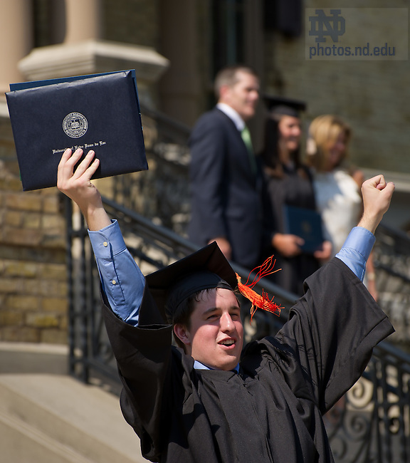 May 20, 2012; Graduates celebrate at the Main Building, Commencement 2012..Photo by Matt Cashore/University of Notre Dame