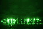 Members of the 11th Marine Expeditionary Unit's Force Reconnaissance Platoon engage in night target practice aided by night vision goggles. Force Recon is the Marine Corps special operations arm.