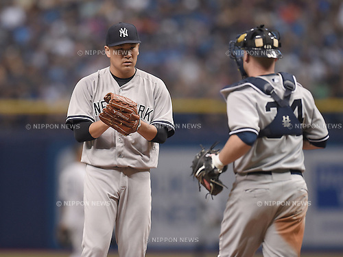 (L-R) Masahiro Tanaka, Brian McCann (Yankees),<br /> APRIL 18, 2015 - MLB :<br /> Pitcher Masahiro Tanaka and catcher Brian McCann of the New York Yankees on the mound during the Major League Baseball game against the Tampa Bay Rays at Tropicana Field in St. Petersburg, Florida, United States. (Photo by AFLO)