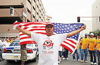 "Phoenix, Arizona. May 1, 2007 - Thousands of immigrants from Latin America and their advocates marched and rallied on May Day in Arizona to continue to push for legislation that would allow a comprehensive immigration reform. The march took place almost a year after massive immigration marches around the country brought the plea of an estimated 12 million undocumented immigrants in the United States into mainstream America. Immigrants also demanded a stop to the immigration raids, deportations and the militarization of the border. This year's march in Phoenix was much smaller than the historic April 10, 2006 march, when tens of thousands of immigrants took the streets to stop a proposed legislation called ""Border Protection, Anti-terrorism, and Illegal Immigration Control Act of 2005,"" also known as H.R. 4437 or Sensenbrenner Bill, which would have criminalized all undocumented immigrants and those who helped them. Photo by Eduardo Barraza © 2007"